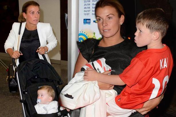 Hình ảnh bà xã và con trai của Rooney tại sân bay Rio de Janeiro