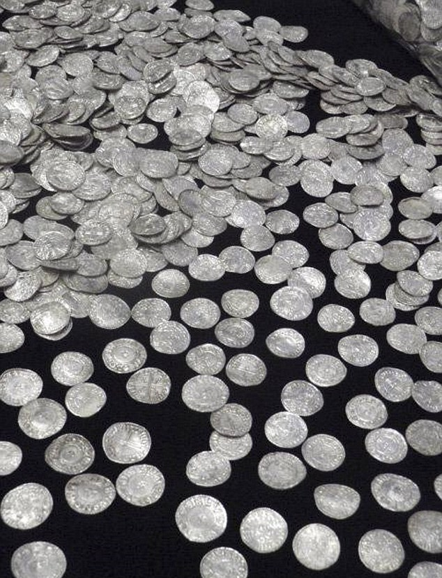 Detectorist finds hoard of 5,000 Anglo-Saxon coins