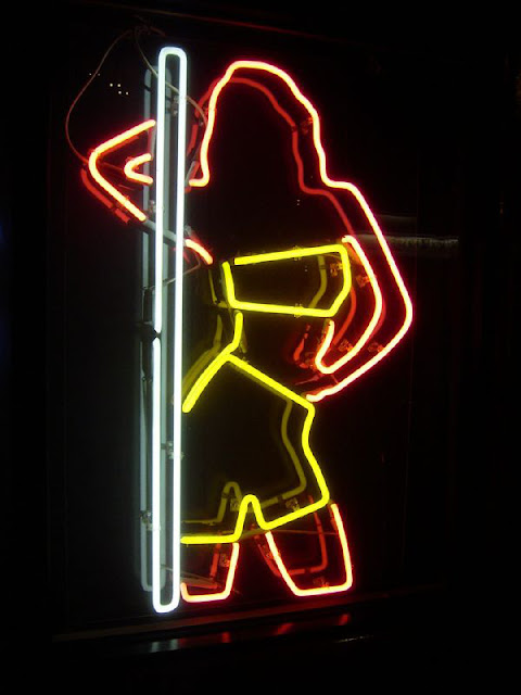 A neon stripper sign