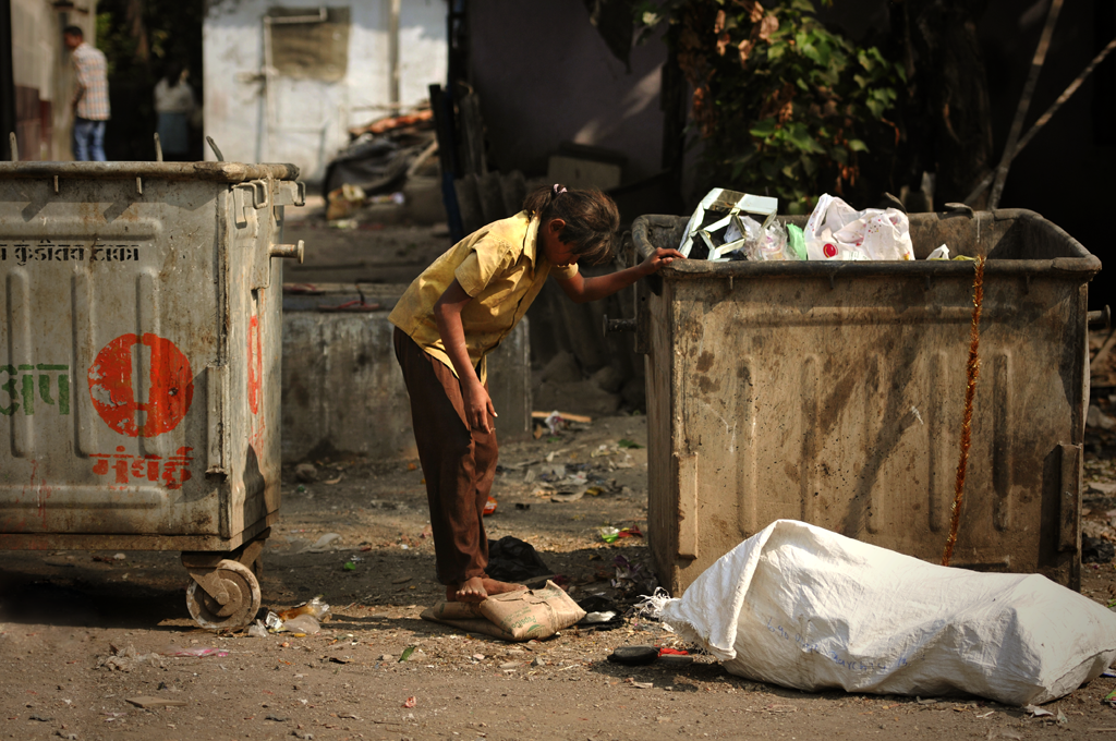 This is a poverty photo of an Indian girl photographed in Mumbai, India.