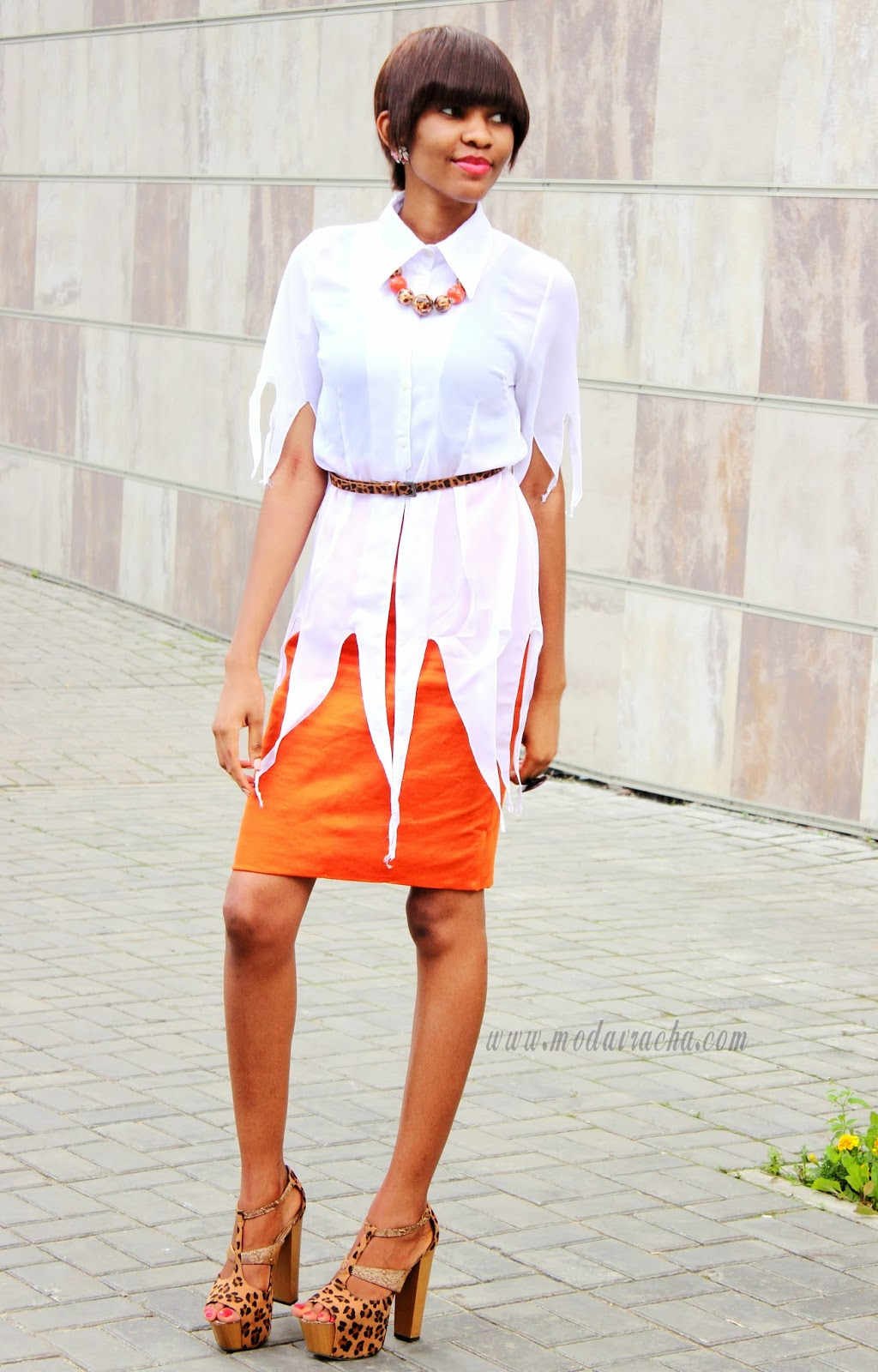 short women hairstyle,orange pencil skirt,leopard print chunky heels,fringed shirt