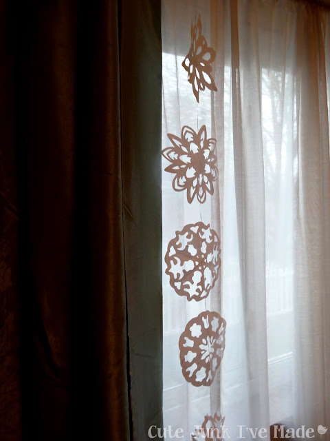 Paper Snowflake Curtain Tutorial - First Strand Hung Up
