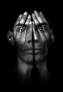 Image of man's face projected on hands