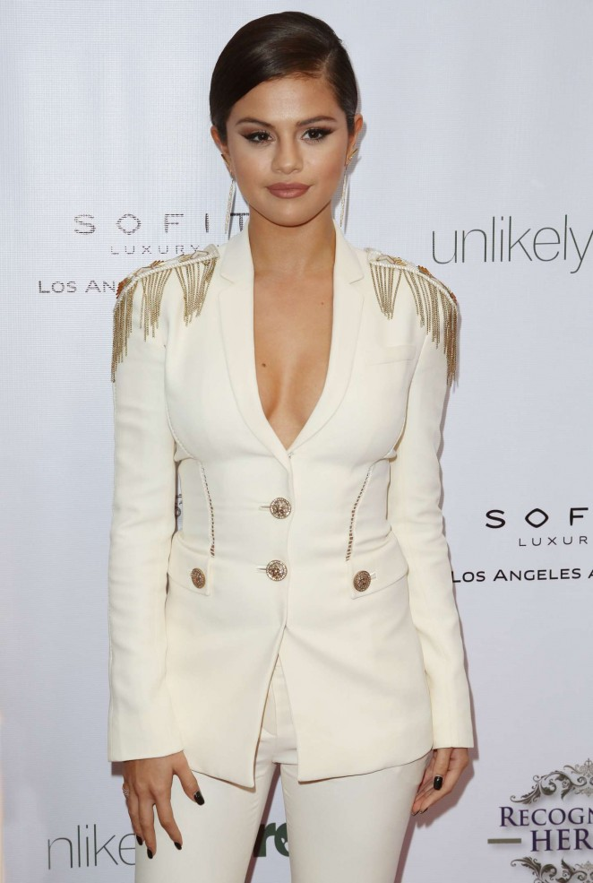 Selena Gomez in a plunging Versace pantsuit at the 2014 Unlikely Heroes Awards Dinner and Gala