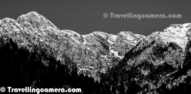 Shrikhand Mahadev in Himachal Pradesh is one of the most difficult Treks, I have done so far. All these photographs are more than 4 years old now, but memories are still fresh in our mind. This Photo Journey is sharing some of the black & White photographs shot during Shrikhand Mahadev Trek in 2008. Let's check out and know more about this wonderful place in Himalayas...Very first photograph shows a huge rock standing still on top of snow covered hill at the height of approximately 1700 feets. This place is of high importance for Shiva followers. This rock is considered as Shivling and every year various pilgrim come to this place from various parts of the country. This Trek opens in July for approximately 3 months. I remember the moment when this Trek was planned by Vikas, Vishal & Narender Ji... I was one of the passive member who was not involved in planning and other folks were best at it :) ... It was very quick plan... Three of us started from Delhi and all of us met at Shimla to start next journey. We went till Nirmand Town in our car and parked it there at some friend's home... From their, we hired a cab to drop us at Jaon Village. jaon village is base from where Shrikhand Mahadev Trek Starts. This whole stretch from Jaon to Shrikhand Mahadev peak was very beautiful with various herbs, plants and flowers on the way...This climb from Jaon to Shrikhand peak took 3 days and third day was mainly through rocky hills with not plants and most of them covered with snow... Last day was challenging one with last stretch was also creating some breathing problems for some of us.. So idea was to reach final destination, spend little time there and come back to Parvali Bag for spending night... During back journey we took 2 days to reach Jaon Village...Here is another photographs from third day of climb.. This place is just above Nain-Sarovar... I call it cloud store... Even this kind of clouds can't be seen from airplane... The size of hills in background will give you some idea about the diameter of this Cloud store.. It was most beautiful moment to see these clouds.. I wish I had a video to share this moment...Here is a photograph showing two of our friends climbing up through snow covered hill around Shrikhand Mahadev Peak. After this stretch some of us started feeling breathing problems but we managed to handle this through some of the medicines we were carrying with us..During this trek to Shrikhand Mahadev, clouds keep walking with you and at times start racing and of-course you can't compete with them :) ... Although these clouds make you most uncomfortable when they plan to throw heavy showers on you, while you have backpack on your shoulders and climbing high...Shrikhand Mahadev Trek is part of Great Himalayan National Park in Kullu District of Himachal Pradesh, India. Although route to reach the place is through Shimla town if you are coming from Delhi or Chandigarh... Weather on these hills is extremely unpredictable... Rains can start anytime... It's hard to see sun after 9am as clouds start moving from one place to another and whole day is spent with roaming clouds.. Most of the times, weather is good for trekking unless rain starts.. After first day, you don't even see trees where you can protect yourself from raindrops...Here is a photograph of fuggy day.. It was day one near Thachru which is one of the halts, where tents can be arranged for night stay but many folks target for Kali-Ghati or Parvati Bag on first day... We stayed at Thacharu as we didn't want to rush.. After first day of trek two of us were down with fever due to sudden change in weather and continuous trekking throughout the day...Here is a photograph of Shrikhand River which starts following you from Baghi-pul and during first day you have to walk through it or along the parallel paths during first half... A beautiful river with chilled water which comes from snow capped peaks around Shrikhand Mahadev Peak.Here is a photograph of Parvati Bag. This is the place which is targeted for first stay by many trekkers and for us it was very aggressive... So on first day we stayed at Thachru and on second day at Foolon ki Ghati which is next to Parwati bag....Lush green hills all around with shining white snow on the top and inside the corners of these hills.... Many of the water sources were also frozen on the way... At times, walking on those was extremely risky and you never know that which part of it has hallow below it...In some of the water streams, flow of water was very high during the day time and it used to increase as time passes in a day... During evening all of these streams used to get highest flow and slows down during night and cycle gets repeated.Here is a nother photograph of one of the hills covered with Hills... But this is much below the Shrikhand Mahadev Peak as we can see some tree in the bottom... This one is probably shot during first day or even on the way from Shimla to Jaon village...One of the rare photographs from Shrikhand Mahadev when we saw uncovered sky which was not wrapped by dense clouds..