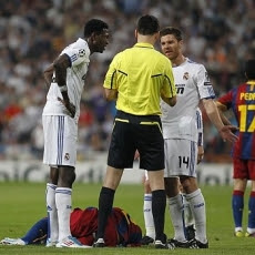 A Barcelona player crying in front of Adebayor