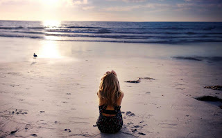 Girl-sitting-alone-in-sea-side-beach-watching-sunset-HD-image.jpg