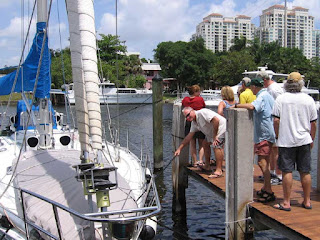 Caribe, a Beneteau First 456, is pulled over to the pier by John Kretschmer