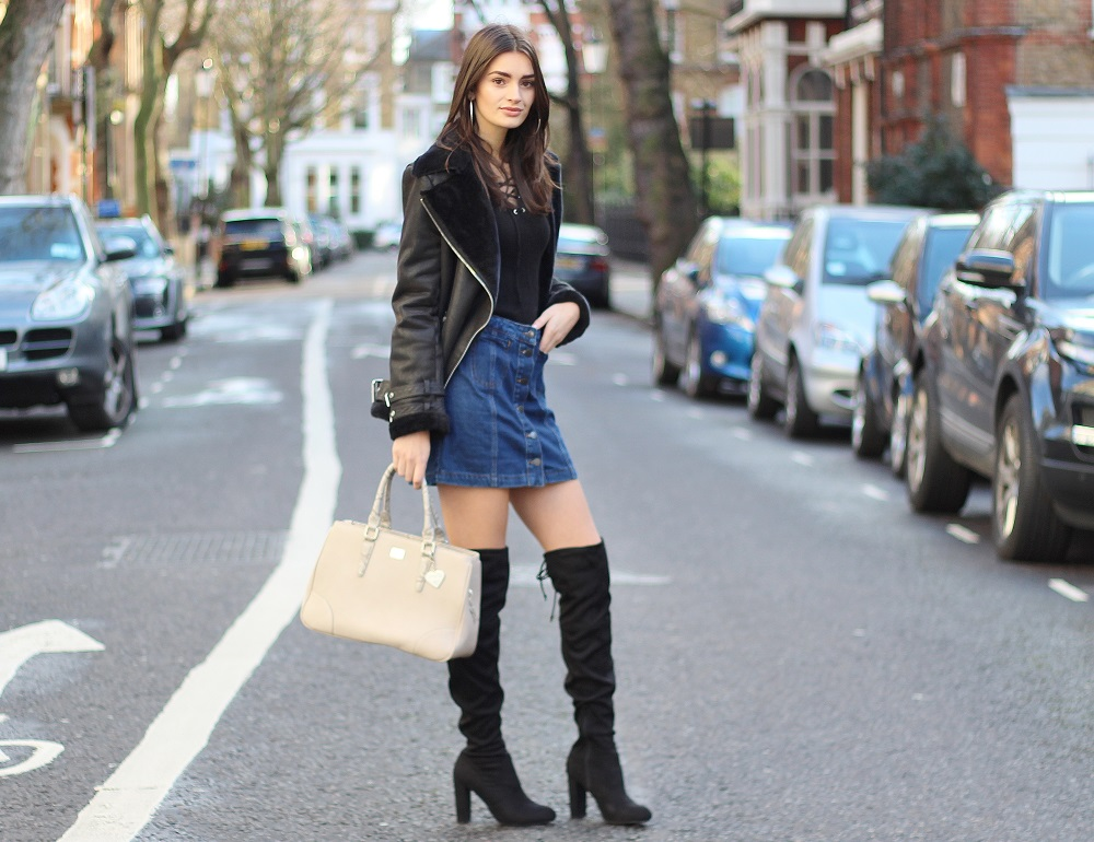 peexo fashion blogger wearing denim skirt and aviator jacket and knee high boots