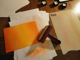 Card brayered with orange inks