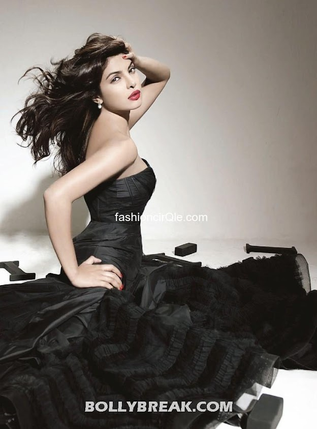 Priyanka in high end fashion stance wearing a black gown -  Shahid Kapoor & Priyanka Chopra's Filmfare – July 2012