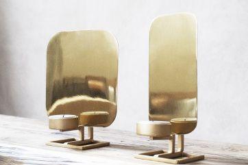 lysestager i guld der passer i tidens dekadente trend