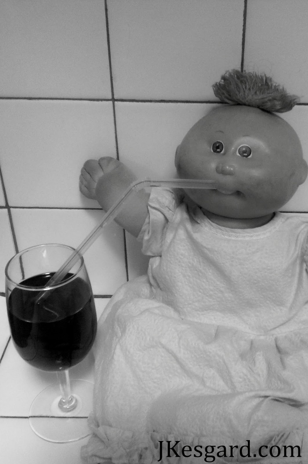 preemie cabbage patch baby drinking blood from a wine glass