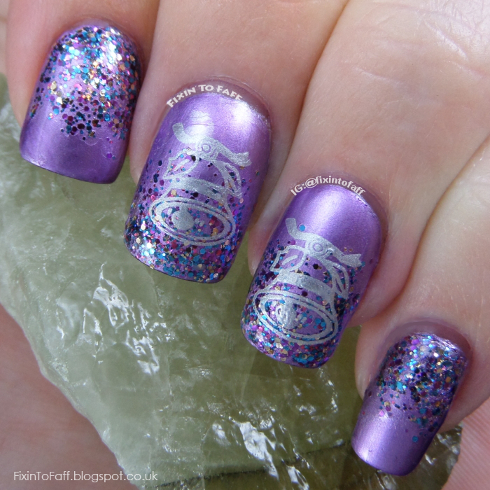 Metallic purple nails with a glitter gradient, topped with stamped silver bells.