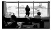 . traveling through gray, rainy and rather shabby LaGuardia Airport. (waitinglga)