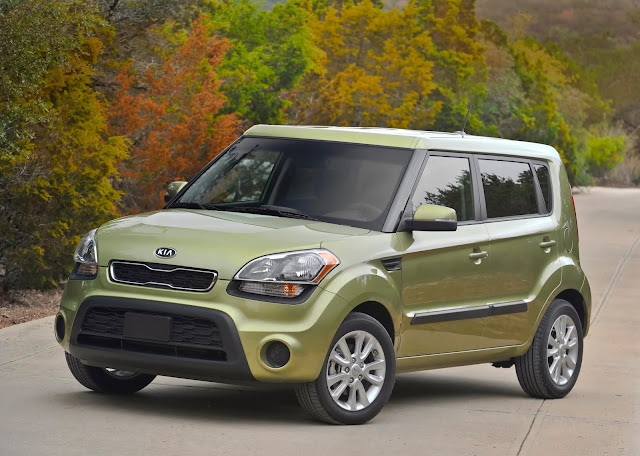 "2013 Kia Soul. They call the color ""Alien""."