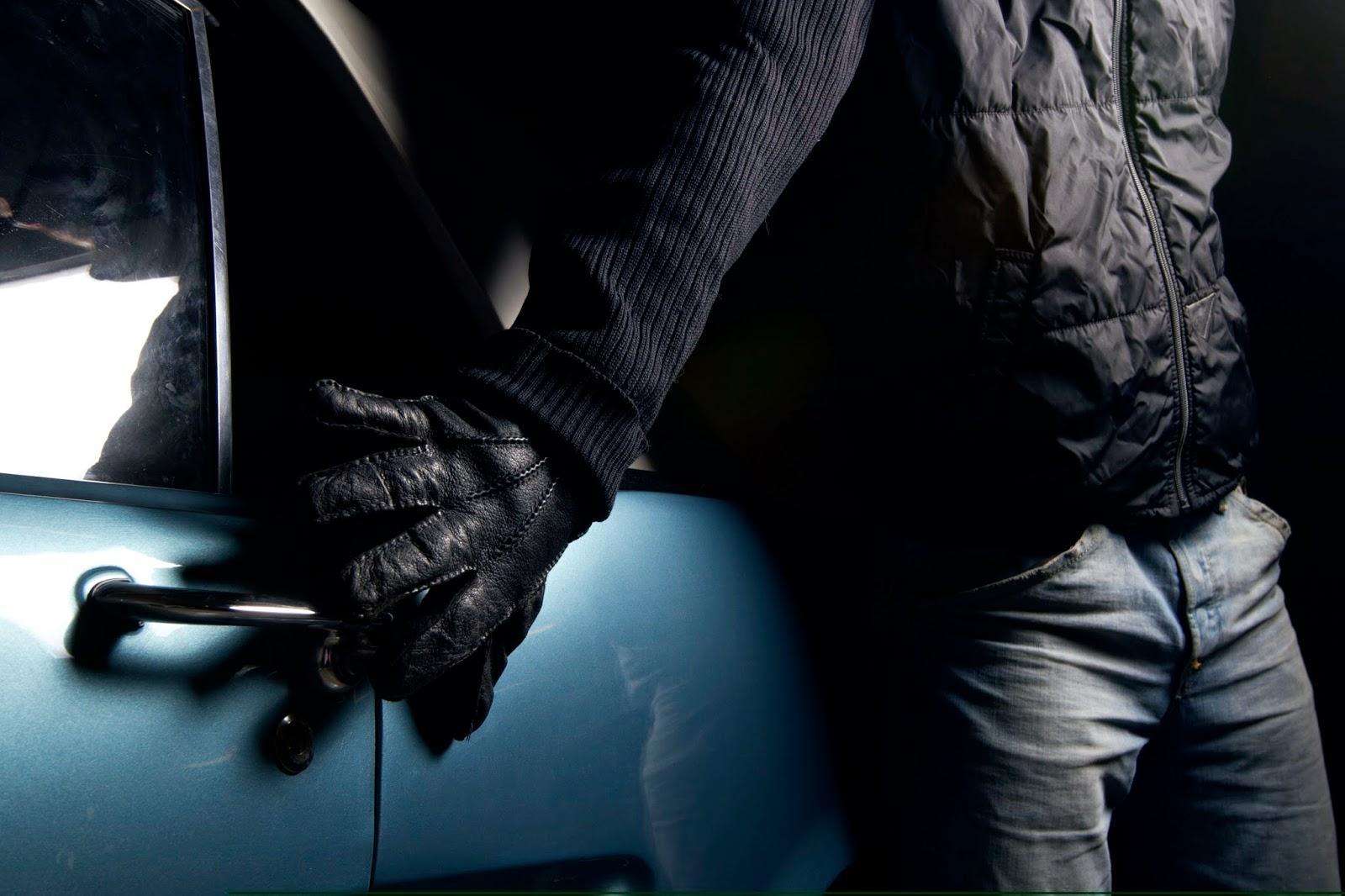 Thief reaching to open car door