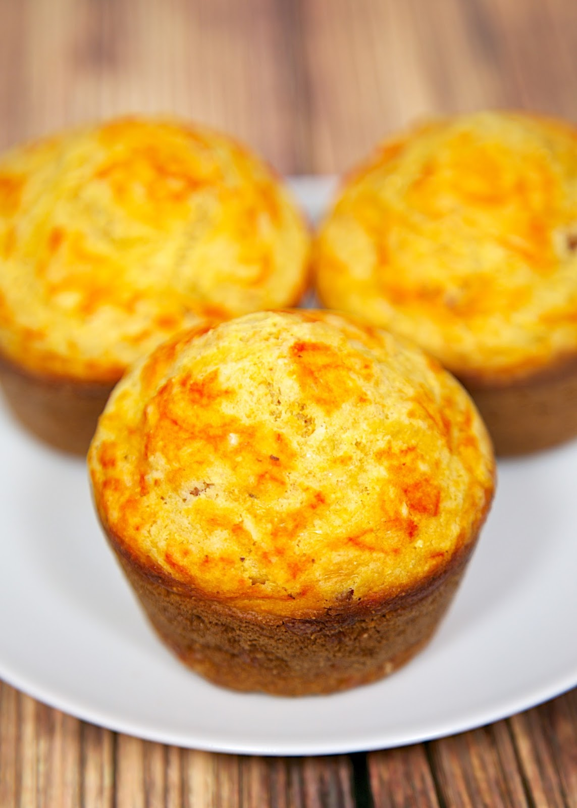 Bacon & Sriracha Corn Muffins Recipe - homemade corn muffins with bacon and a swirl of Sriracha. Great with soups, stews and grilled meats.