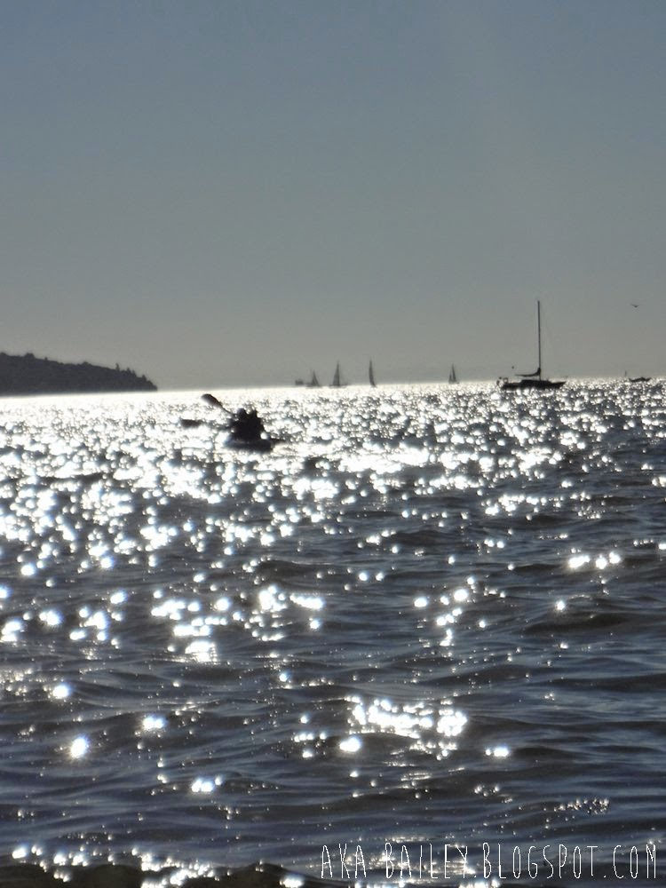 Kayaking into the sun in English Bay in Vancouver, from Kitsilano Beach