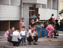 Ordinary People (unaware of camera), family street scene, Pyongyang, North Korea