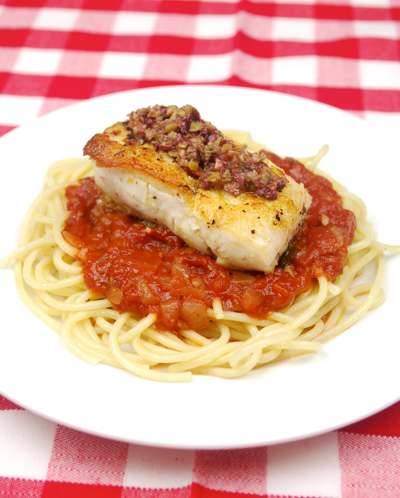 Tasty trials a laromanella recipe tapenade topped halibut for Italian entree recipes