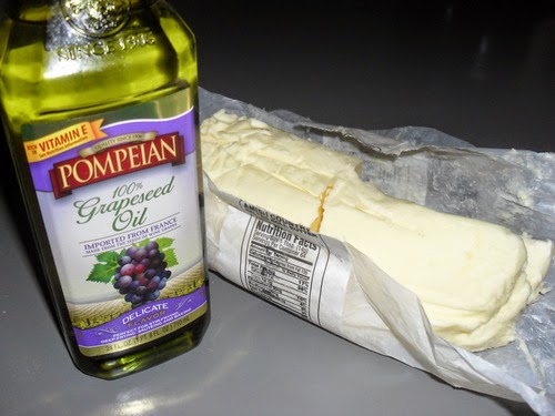 A brick of Amish butter and a jar of Grapeseed Oil
