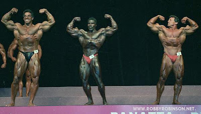 """THE BLACK PRINCE"" ROBBY ROBINSON - MR OLYMPIA 1994 MASTERS POSE DOWN WITH LOU FERRIGNO AND BOYER COE  Read about RR's training and life experience, about other legends  of Golden Era of bodybuilding and what really happened  behind the scenes of Weider's empire - in RR's BOOK  ""The BLACK PRINCE; My Life in Bodybuilding: Muscle vs. Hustle"" -  ▶ www.robbyrobinson.net/books.php"
