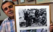 Jovenes Soldados Argentinos puestos en una fosa comun despues de la Batalla . rtr mg