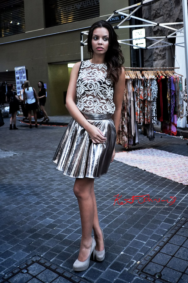 Model wearing  Eyvie lace top, St Frock metallic skirt Tina Tran necklace, cross section markets Angel Place Sydney