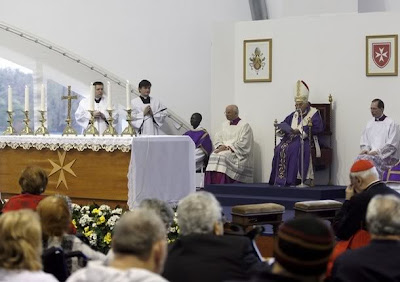 Pope Benedict XVI leaves after a mass celebrated at the Roman Hospital San Giovanni Battista of S.M.H.O in Rome