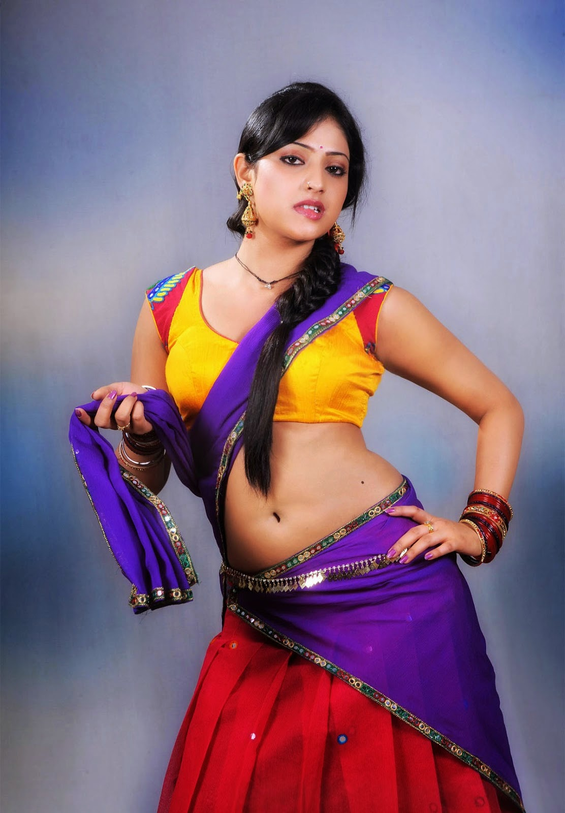 Hari Priya in a Village girl attire wearing Half Saree