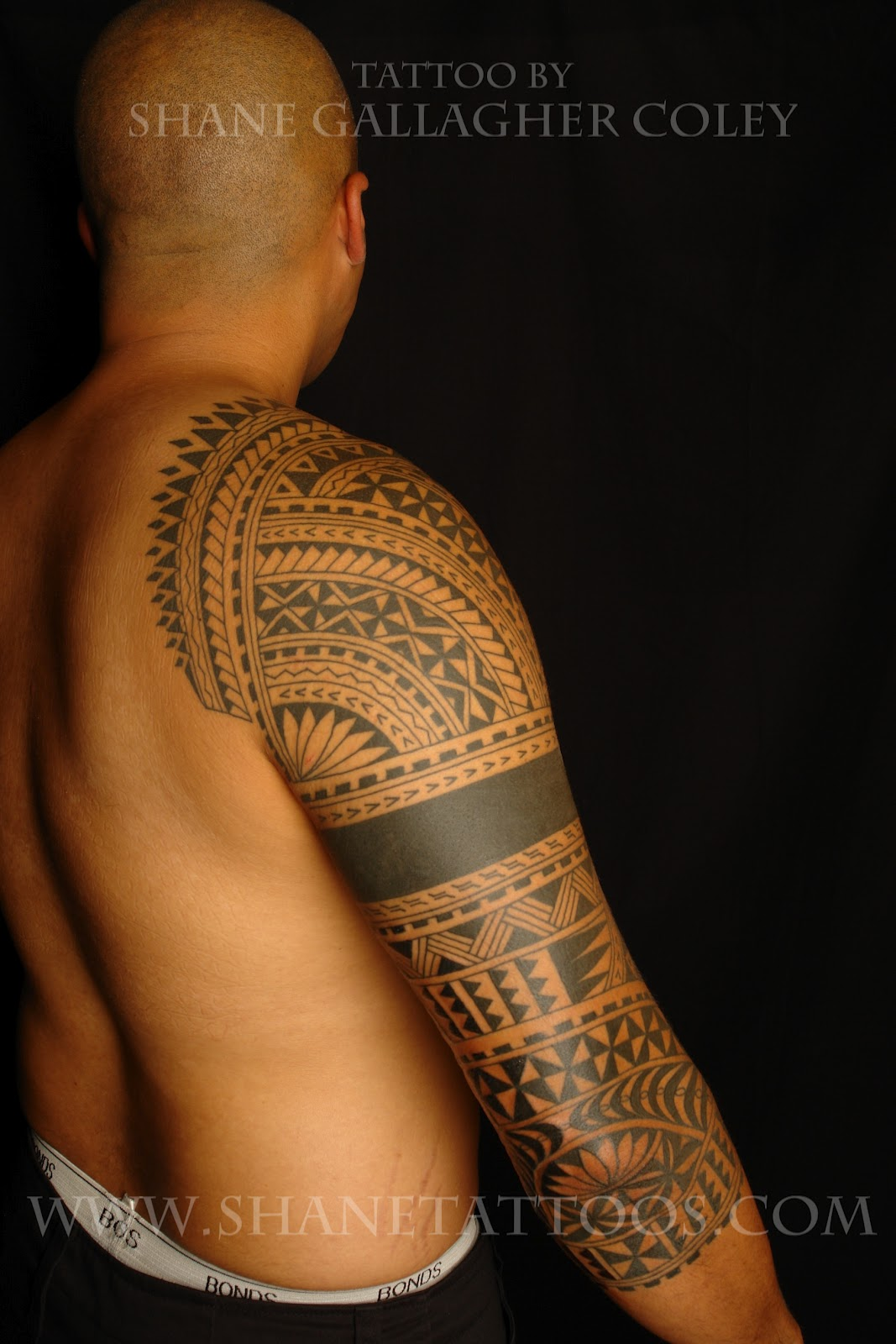 Shane tattoos cook islands polynesian sleeve on james