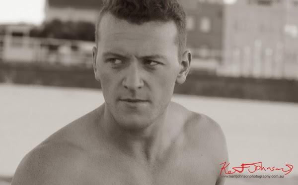 Black and white headshot, at Bondi Beach men's model portfolio by Kent Johnson.