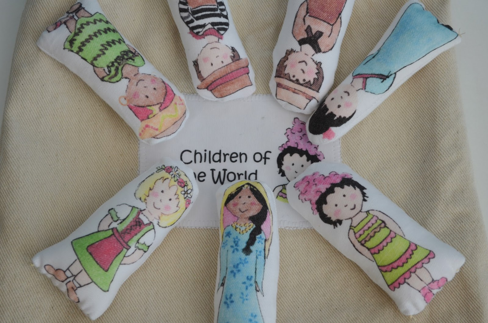 Snugglebug university children of the world fabric dolls for Children of the world fabric