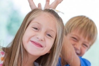 NAMC Montessori homeschool develop social skills boy and girl playing