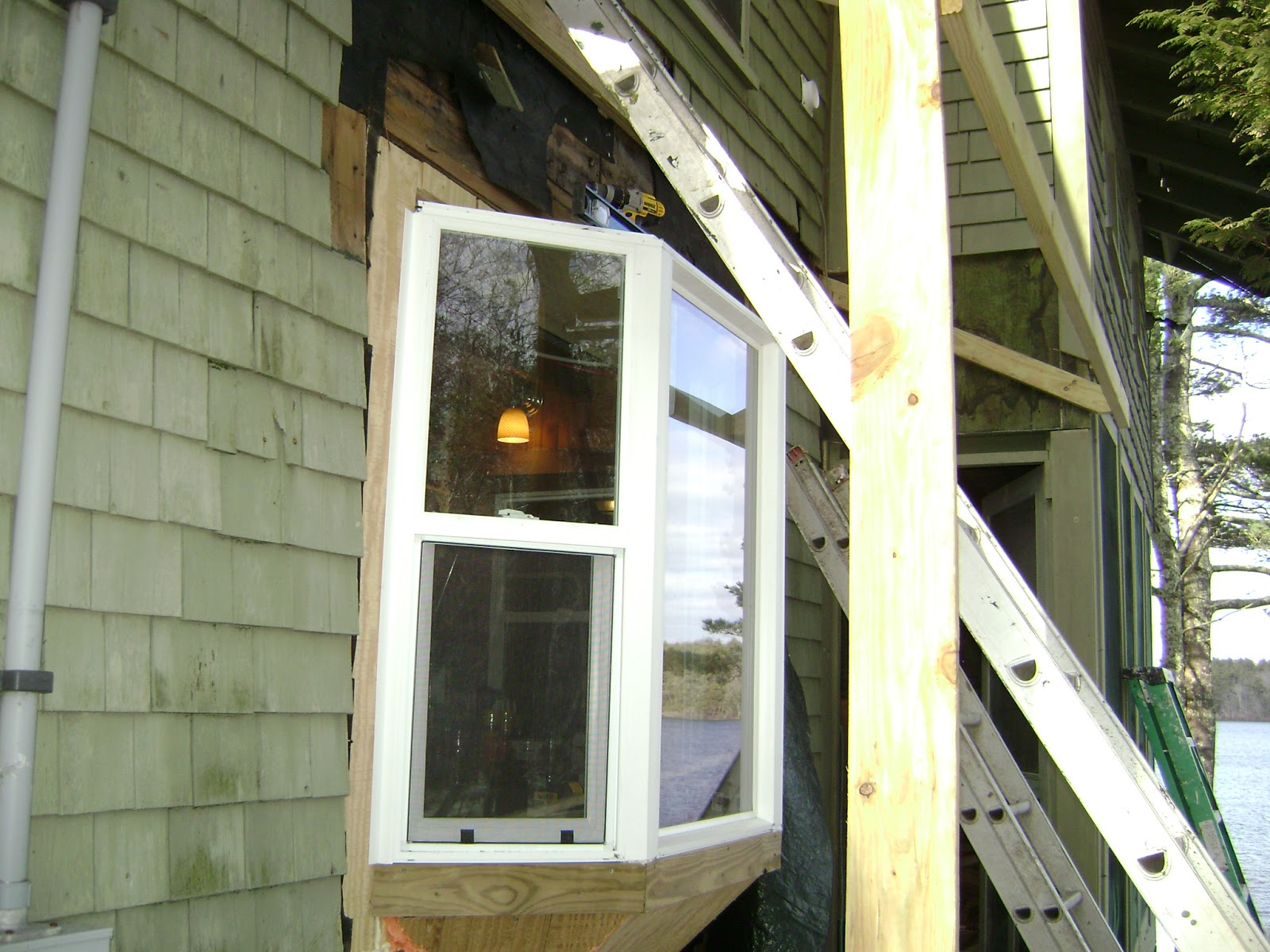 Long pond endeavor company bay window with new shed roof for New window company