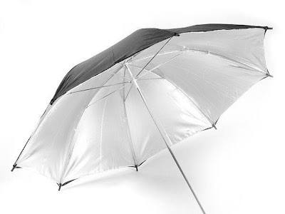 A Silver Coated Umbrella Used for Photography