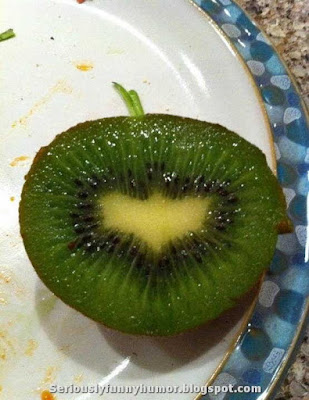 Kiwi with an inside looking like Batman sign
