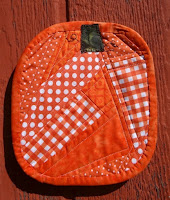 http://www.patchworkposse.com/fall-pumpkin-mug-rug-tutorial/