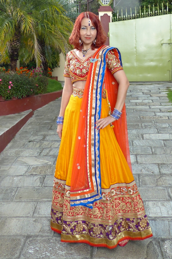 Colourful lehenga choli party outfit worn with peacock theme jewelry