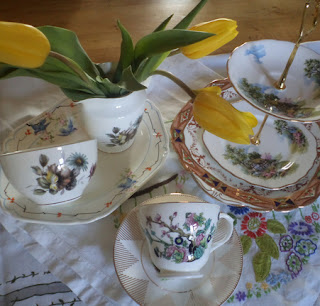 teacups and saucers, and a cake stand