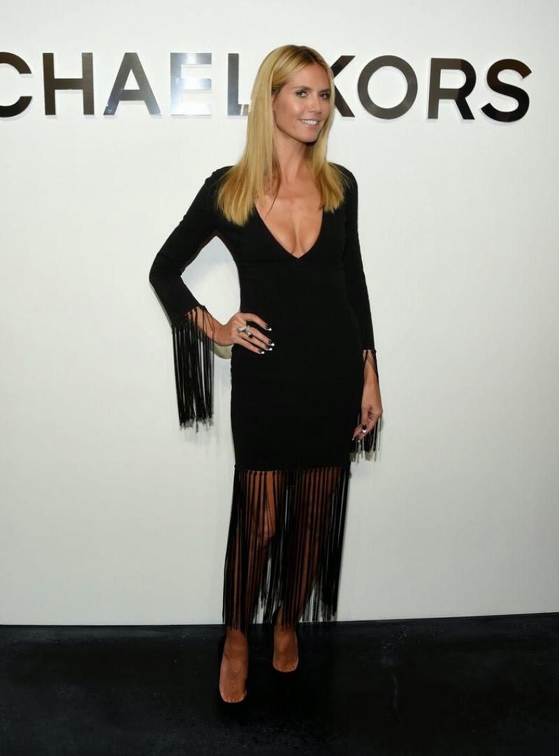 Heidi Klum wears a low-cut fringed dress to the Michael Kors Spring 2015 New York Fashion Week Show