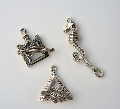 Dragon and castle, seahorse and Egyptian Eye clasps