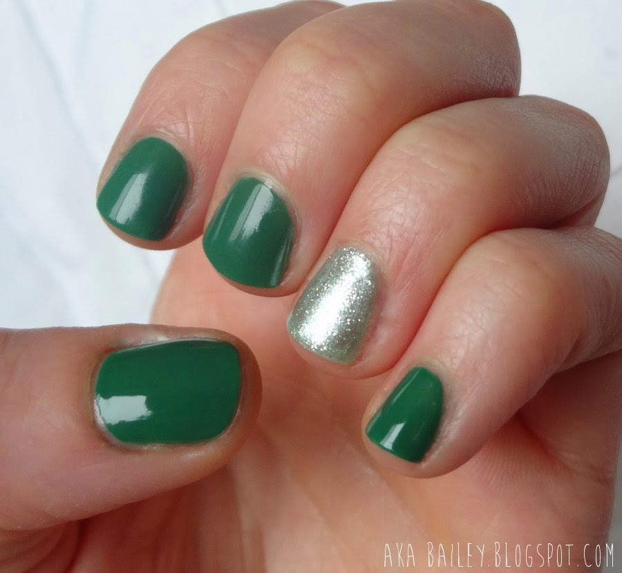 Green nails with a minty silver accent nail