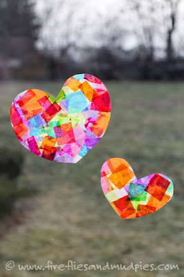http://www.firefliesandmudpies.com/2015/01/06/rainbow-heart-suncatchers/