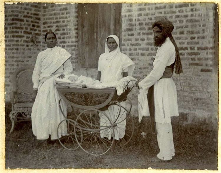 Three Indian Servants wih an European Baby in a Hand Driven Car - c1900s