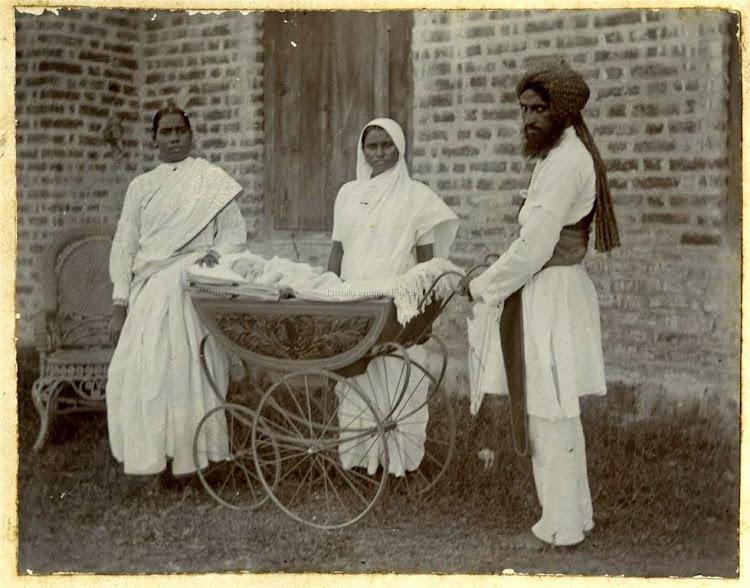 Three Indian Servants wih an European Baby in a Hand Driven Car - c1900s