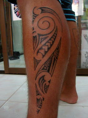 Maori style leg tattoo