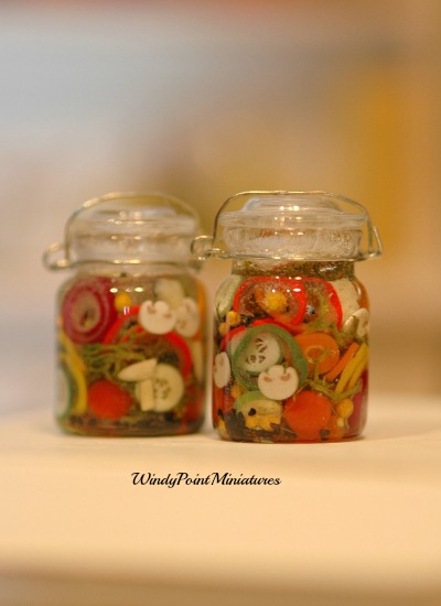 CDHM Artisan Jennifer Reed of Windy Point Miniatures making 1:12 foods including canned vegetables, fancy flatware, cakes, platted meal for the dollhouse miniature collector