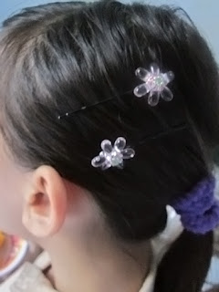 Wearing_beaded_flower_embellished_hairpin